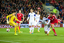 13.10.2014, City Stadium, Cardiff, WAL, UEFA Euro Qualifikation, Wales vs Zypern, Gruppe B, im Bild The ball flies past Cyprus' goalkeeper Tasos Kissas as David Cotterill (not in frame) scores the opening goal against Cyprus // 15054000 during the UEFA EURO 2016 Qualifier group B match between Wales and Cyprus at the City Stadium in Cardiff, Wales on 2014/10/13. EXPA Pictures © 2014, PhotoCredit: EXPA/ Propagandaphoto/ David Rawcliffe<br /> <br /> *****ATTENTION - OUT of ENG, GBR*****
