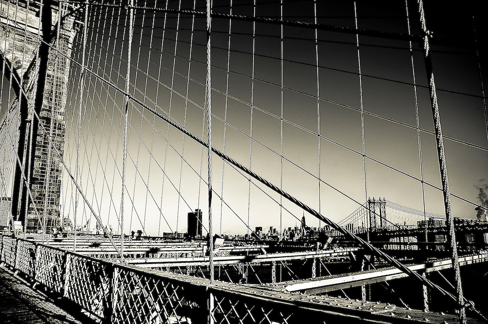 Cables of the Brooklyn Bridge with the Manhattan Bridge and the top of the Empire State Building in the background, Brooklyn, New york, 2008.