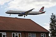 Andy; Andrew; Aitchison; Heathrow; airport; London; United; Kingdom; UK; plane; airplane; transport; flying; airborne; house; home; flight; path; takeoff; blue; sky; clouds; Longford; Hounslow; BA; British; airlines; airways; 747; roof; rooftop; tiles; chimney; noise; pollution; disruption; BAA; residential; 777,