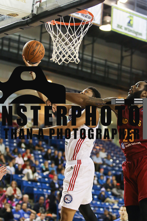 Philadelphia 76ers assignee Christian Wood (33) drives towards the basket as Fort Wayne Mad Ants Forward Rakeem Christmas (25) defends in the first half of a NBA D-league regular season basketball game between the Delaware 87ers and the Fort Wayne Mad Ants Wednesday. Dec 09 2015, at The Bob Carpenter Sports Convocation Center in Newark, DEL