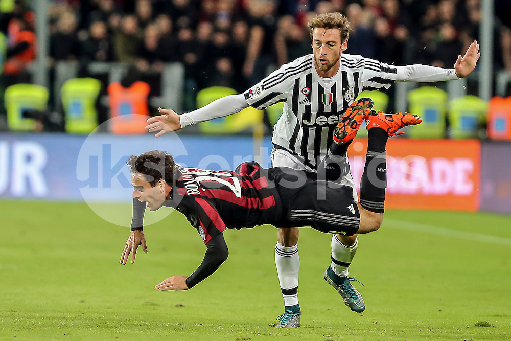Giacomo Bonaventura of AC Milan is tackled by Claudio Marchisio of Juventus during the Serie A TIM match between Juventus and AC Milan at the Juventus Stadium, Turin, Italy on 21 November 2015. Photo by sync studio.