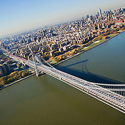Aerial view of Manhattan from a helicopter over the Williamsburg Bridge.