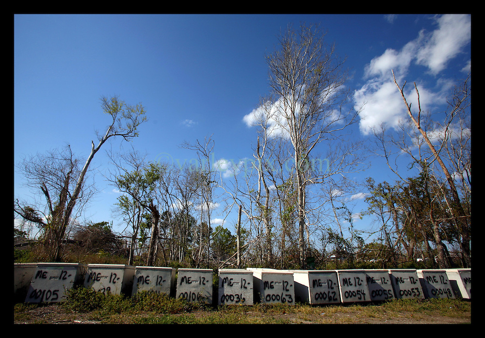 March, 27th, 2006. The road to the end of St Bernard Parish, east of New Orleans. Seven months after the storm, cement coffins, filled with the original wooden coffins that were washed away by Hurricane Katrina and were collected from all over the area, await re-interring at Merrick cemetery, one of the oldest slave cemeteries in the south.