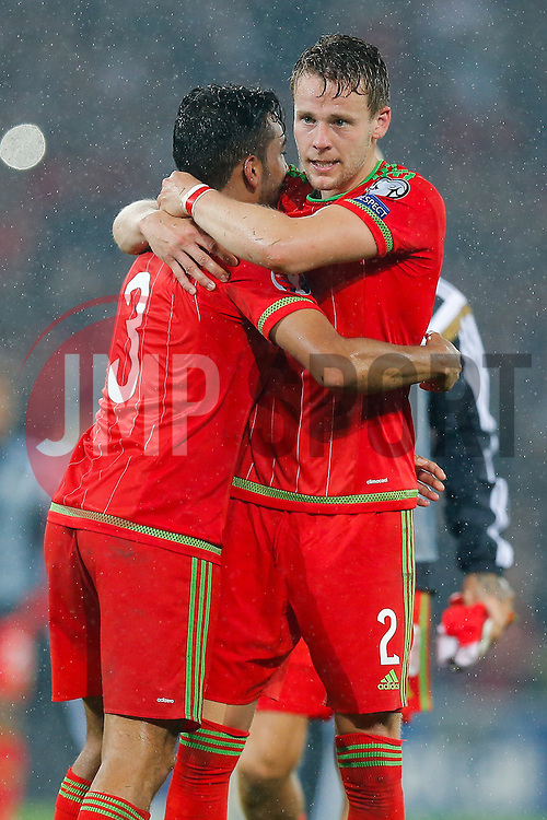 Chris Gunter (Reading) hugs Neil Taylor (Swansea City) after Wales win the match 1-0 to top their UEFA2016 Qualifying Group - Photo mandatory by-line: Rogan Thomson/JMP - 07966 386802 - 12/06/2015 - SPORT - FOOTBALL - Cardiff, Wales - Cardiff City Stadium - Wales v Belgium - EURO 2016 Qualifier.