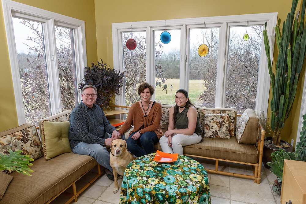 Cooper the Wonder Dog, 9, with Kristen and David Embry and their daughter Gabby, 13, in the sun room at their home in Pendleton, Ky. Feb. 22, 2018