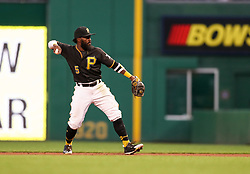 Jun 15, 2018; Pittsburgh, PA, USA; Pittsburgh Pirates second baseman Josh Harrison (5) throws a ball to first base during the fifth inning against the Cincinnati Reds at PNC Park. Mandatory Credit: Ben Queen-USA TODAY Sports