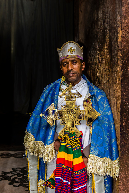 Priest holding the original 12th century gold St. George's cross (weighs 7 kilos), Beta Giyorgis (St. George's church), one of 11 rock hewn churches, Lalibela, Ethiopia.