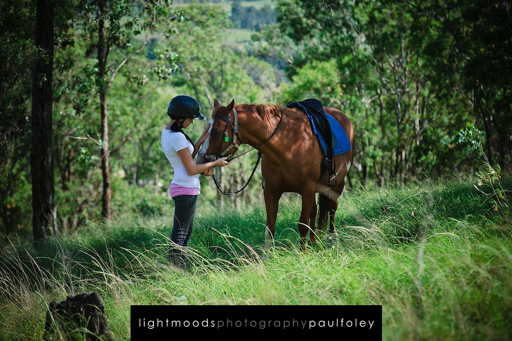 Young Woman riding a horse in Australian Bush, Hunter Valley, Australia