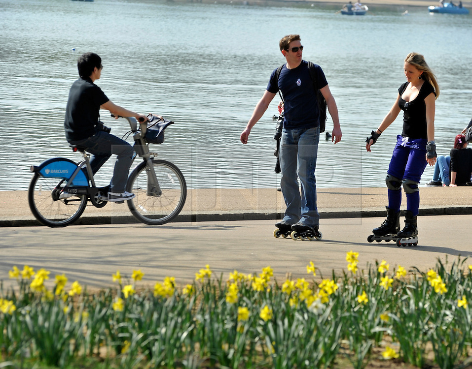 © Licensed to London News Pictures. 24/03/2012. London, UK. People roller blading along the Serpentine Lake. People enjoy the warm sunshine today 24 March 2012 in Hyde Park Central London . Photo credit : Stephen SImpson/LNP