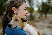 Natalie Mathiason, a vulunteer at the shelter, holds one of the rescued puppies.