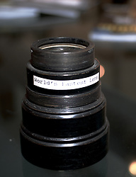 "A very light sensitive lens built by the US Army Signal Corps Engineering Laboratories. The label on this single aperture f/0.6 33mm fixed focal length lens reads ""World's Fastest Lens"". While this claim might be true in the days it was manufactured, today several other lenses claim the same. This lens is presumably designed for night-vision or x-ray use.<br /> <br /> ...<br /> <br /> November 18, 2011 - Philadelphia, PA; An impressive collection of more than 350 old cameras will be put up for auction on Saturday, Nov. 19, 2011 at Fuller's Fine Art Auctions in Philadelphia, PA.<br /> <br /> ( A selection of photos from this collection are published with the Nov 18, 2011 article by Alan Tu on WHYY's NewsWorks.org: ""Vintage cameras to be auctioned off Saturday by Mt. Airy auction house"" - You can read the article here: http://www.newsworks.org/index.php/local//mt-airychestnut-hill/30073-vintage-cameras-to-be-auctioned-off-saturday-by-mt-airy-auction-house )<br /> <br /> The cameras were collected by Edward Kaprelian (1913-1997), who after WWII became an expert on camera and lens technology. In May 1945, the U.S. Army seized more than 2,000 Carl Zeiss lenses from Germany as ""war reparations"" and turned them over to Kaprelian, who was then serving as Chief of the U.S. Army Signal Corps Engineering Labs in Fort Monmouth, N.J. <br /> <br /> Kaprelian went on to become an avid collector of photographic equipment and materials during his lifetime and amassed a large collection of important cameras spanning the history of photography."