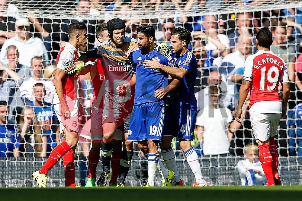 Petr Cech of Arsenal tries to keep apart Gabriel Paulista and Diego Costa of Chelsea as they argue - Mandatory byline: Rogan Thomson/JMP - 07966 386802 - 19/09/2015 - FOOTBALL - Stamford Bridge Stadium - London, England - Chelsea v Arsenal - Barclays Premier League.