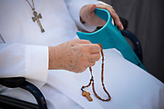 A Religious Sister Prays the Rosary at the General Audience