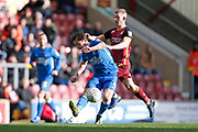 Peterborough United midfielder Alex Woodyard (4) is tackled by Bradford City forward Eoin Doyle (9)  during the EFL Sky Bet League 1 match between Bradford City and Peterborough United at the Northern Commercials Stadium, Bradford, England on 9 March 2019.