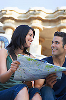 Young couple holding map portrait