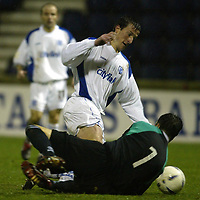 Raith Rovers v St Johnstone...29.11.03<br />Chris Hay rounds keeper Jamie Langfield to put St Johnstone 2-0 up<br /><br />Picture by Graeme Hart.<br />Copyright Perthshire Picture Agency<br />Tel: 01738 623350  Mobile: 07990 594431