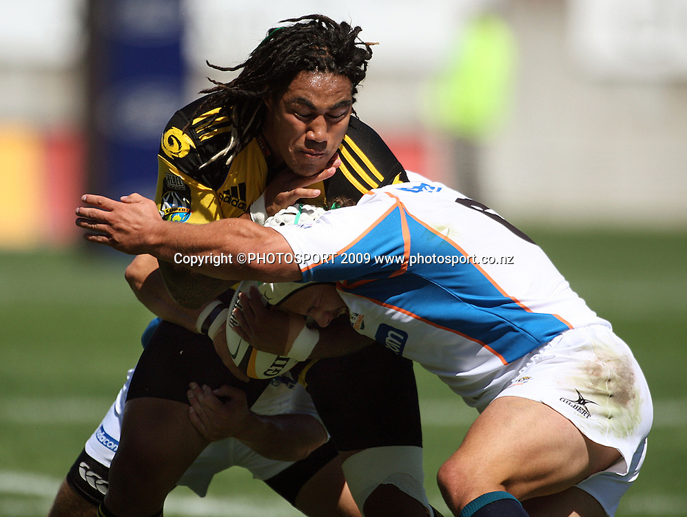 Hurricanes second five Ma'a Nonu crashes into the tackle of Heinrich Brussow.<br /> Super 14 rugby union match, Hurricanes v Cheetahs at Yarrows Stadium, New Plymouth, New Zealand. Saturday 7 March 2009. Photo: Dave Lintott/PHOTOSPORT