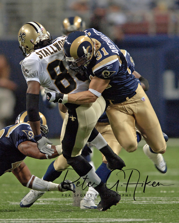 Rams strong safety Adam Archuleta (31) wraps up New Orleans wide receiver Dante Stallworth (83) during game action at the Edward Jones Dome in St. Louis, Missouri, October 23, 2005.  The Rams beat the Saints 28-17.