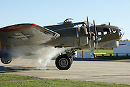 Montgomery, New York- A pilot starts an engine on a B-17 Flying Fortress Bomber from Collings Foundation at Orange County Airport on Oct. 2, 2010.