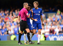 Willian of Chelsea and Marcos Alonso of Chelsea confront Referee Craig Pawson  - Mandatory by-line: Alex James/JMP - 12/08/2017 - FOOTBALL - Stamford Bridge - London, England - Chelsea v Burnley - Premier League