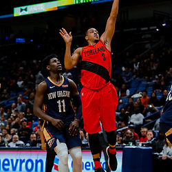 Jan 12, 2018; New Orleans, LA, USA; Portland Trail Blazers guard CJ McCollum (3) shoots over New Orleans Pelicans guard Jrue Holiday (11) during the second half at the Smoothie King Center. The Pelicans defeated the Trail Blazers 119-113. Mandatory Credit: Derick E. Hingle-USA TODAY Sports