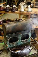 Nederland, Waalwijk, 20090420.<br /> Schoenfabriek H. Greve in Waalwijk.<br /> handgemaakte schoenen uit Waalwijk sinds 1898. Ze zijn hofleverancier.<br /> In het hart van de Langstraat, in de stad Waalwijk, begon Hermanus Greve in 1898 een schoenmakerij. Vanaf het prille begin had de werkplaats slechts &eacute;&eacute;n doel voor ogen: Nederlands meest stijlvolle en superieure schoenen maken. Greve is daardoor altijd &eacute;&eacute;n van de kleinere werkplaatsen van de Langstraat geweest maar tegelijk ook de meest exclusieve. De herinnering aan een rijk verleden leeft hier vandaag de dag nog steeds voort. We zijn een trots familiebedrijf dat onder leiding staat van inmiddels de 4e generatie, Jos Jan Greve.<br /> <br /> Netherlands, Waalwijk, 20090420. <br /> Shoe industry Greve in Waalwijk. <br /> handmade shoes from Waalwijk since 1898.<br /> In the heart of the Langstraat, in the city of Waalwijk, Hermanus Greve started in 1898 a shoemaker. From the very beginning, the workshop is only one goal: to make Dutch most stylish and superior shoes. Greve has therefore always been one of the smaller workshops of Langstraat but it is also the most exclusive. The memory of a glorious past alive here today still continues. We are a proud family business headed by now the 4th generation, Jos Jan Greve.