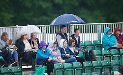 LIVERPOOL, ENGLAND - Thursday, June 21, 2012: Spectators watch under umbrellas during the opening day of the Medicash Liverpool International Tennis Tournament at Calderstones Park. (Pic by David Rawcliffe/Propaganda)