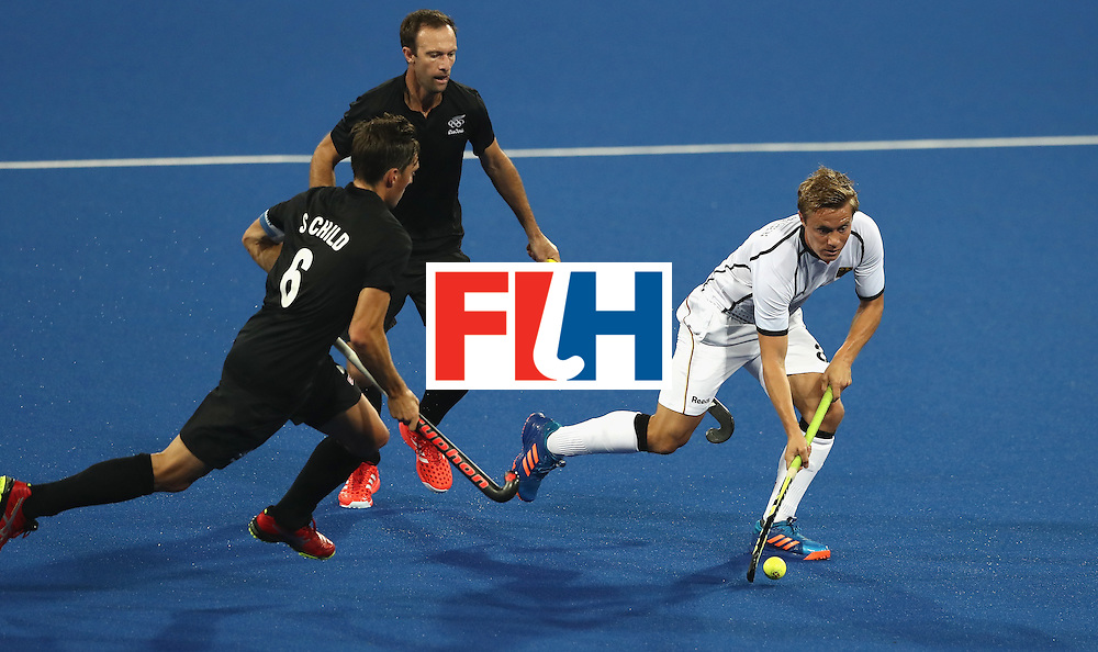 RIO DE JANEIRO, BRAZIL - AUGUST 14:  Mats Grambusch of Germany breaks with the ball during the Men's hockey quarter final match between the Germany and New Zealand on Day 9 of the Rio 2016 Olympic Games at the Olympic Hockey Centre on August 14, 2016 in Rio de Janeiro, Brazil.  (Photo by David Rogers/Getty Images)
