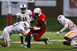10 September 2011: Kyle Manley lunges for the legs of Ashton Leggett with Dexter Geohagen moving in the other side during an NCAA football game between the Morehead State Eagles and the Illinois State Redbirds at Hancock Stadium in Normal Illinois.