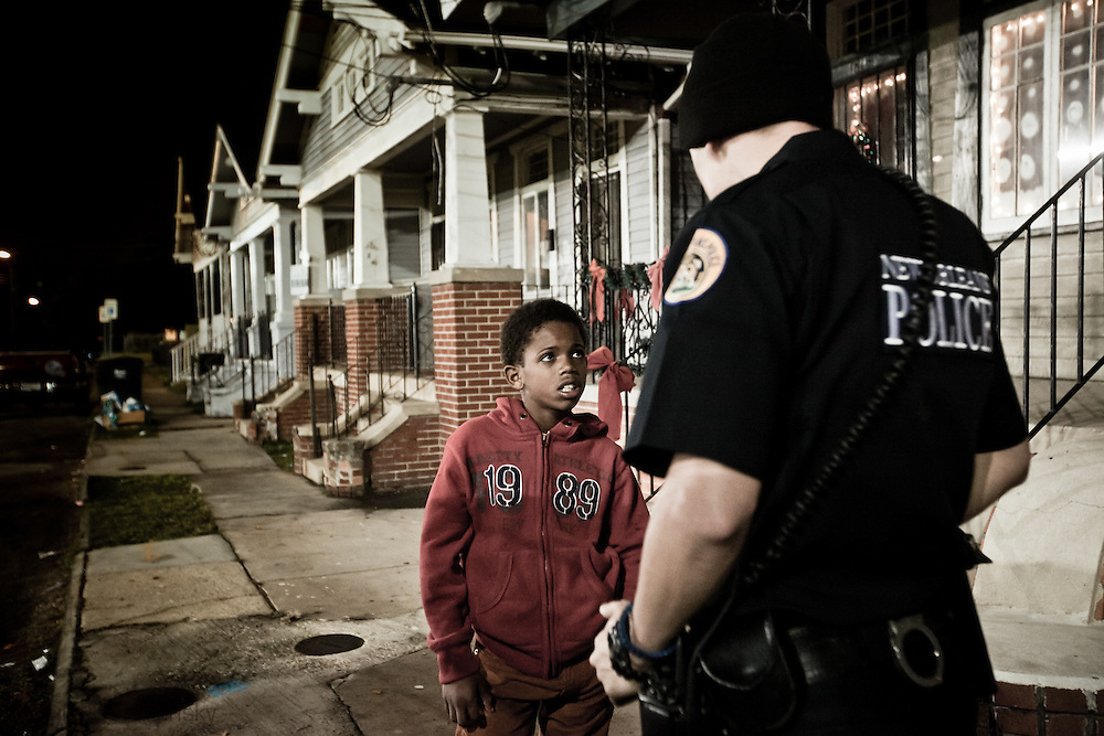 December 25th, 2011, New Orleans,<br /> A young boy listens to a police officer's warning about what his future will bring if he doesn't straighten out after he is caught fleeing with a group of other minors out after curfew. New Orleans crime rate is among the highest in America and is considered to be one of the most dangerous cities in the world.
