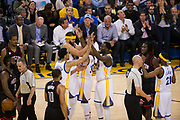 The Golden State Warriors celebrate after a basket against the Houston Rockets at Oracle Arena in Oakland, Calif., on March 31, 2017. (Stan Olszewski/Special to S.F. Examiner)