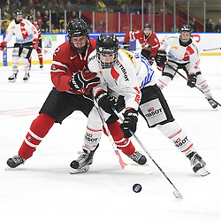 WHITBY, - Dec 13, 2015 -  WJAC Game 2- Team Switzerland vs Team Canada East at the 2015 World Junior A Challenge at the Iroquois Park Recreation Complex, ON. Owen Grant #2 of Team Canada East tries to keep the puck from Fabian Berni #9 of Team Switzerland during the second period.(Photo: Andy Corneau / OJHL Images)