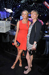 Left to right, TESS DALY and SARA COX at the F1 Party in aid of Great Ormond Street Hospital Children's Charity held at Battersea Evolution, Battersea Park, London on 4th July 2012.