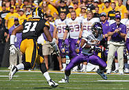 September 15 2012: Northern Iowa Panthers running back Carlos Anderson (1) pulls in a pass as Iowa Hawkeyes linebacker Anthony Hitchens (31) closes in during the first quarter of the NCAA football game between the Northern Iowa Panthers and the Iowa Hawkeyes at Kinnick Stadium in Iowa City, Iowa on Saturday September 15, 2012. Iowa defeated Northern Iowa 27-16.