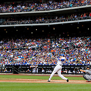 NEW YORK, NEW YORK - July 05: Wilmer Flores #4 of the New York Mets drives in the tying run in the seventh inning with a sacrifice fly  during the Miami Marlins Vs New York Mets regular season MLB game at Citi Field on July 04, 2016 in New York City. (Photo by Tim Clayton/Corbis via Getty Images)