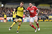 Burton Albion defender Tom Naylor (15) clears the ball from Nottingham Forest midfielder Lee Tomlin (15) during the EFL Sky Bet Championship match between Burton Albion and Nottingham Forest at the Pirelli Stadium, Burton upon Trent, England on 17 February 2018. Picture by Richard Holmes.