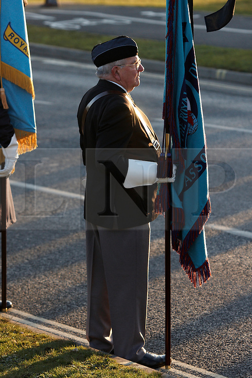 © Licensed to London News Pictures.  02/02/2012. CARTERTON, UK. Standard bearer braves a bitterly cold day during the repatriation ceremony for Signaller Ian Sartorius-Jones, 200 Signals Squadron, who died on Tuesday 24 January 2012 at Forward Operating Base Khar Nikah in the Nahr-e Saraj district of Helmand province, Afghanistan. Photo credit :  Cliff Hide/LNP