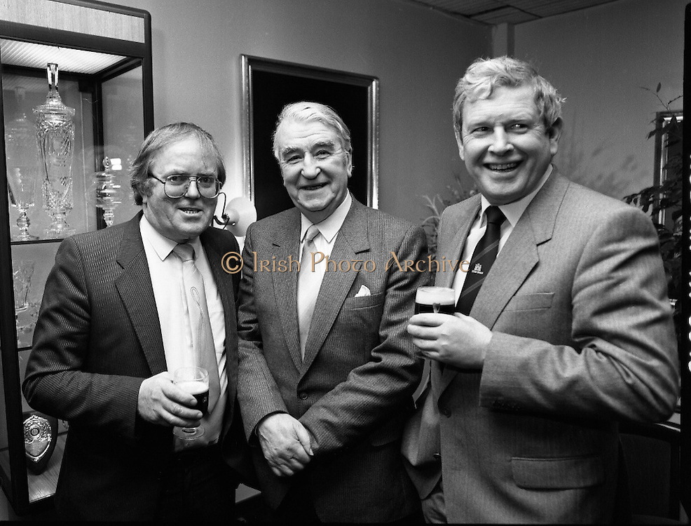 Kerry Person Of The Year.   (R73)..1988..15.02.1988..02.15.1988..15th February 1988..Dr Bryan McMahon of Listowel, Co Kerry has been selected as 'Kerry Person of The Year' for 1988. It was announced at a reception at in The Guinness Brewery, St James's Gate, Dublin...Image shows (L-R), Mr Ned O'Shea,Chairman, Kerry Association, Dublin, Dr Bryan McMahon and Mr Pat Healy, Sales Director,Guinness Group Sales at the reception centre in the brewery.