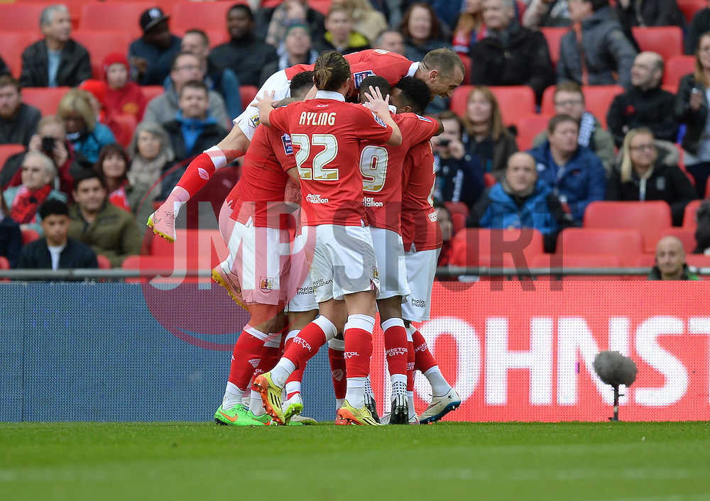 Bristol City's Aden Flint celebrates with team. - Photo mandatory by-line: Alex James/JMP - Mobile: 07966 386802 - 22/03/2015 - SPORT - Football - London - Wembley Stadium - Bristol City v Walsall - Johnstone Paint Trophy Final