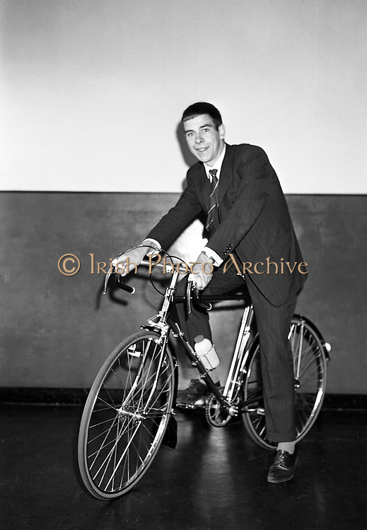 Seamus O'Hanlon, winner of Rás Tailteann, the annual eight day international cycling stage race.<br /> 1962. 14.08.1962. 08.14.1962. 14th August 1962.<br /> A presentation of a Raleigh 'Gran Sport' bicycle complete with Capagnolo 10 speed gear system was made to Seamus O'Hanlon, a twenty-year-old Dubliner, who won the Rás Tailteann this year. The presentation was made as he toured the Irish Raleigh Industries factory at Hanover Quay, Dublin.<br /> Picture shows Seamus O'Hanlon astride the bicycle he was presented with during his visit to the Raleigh Factory at Hanover Quay, Dublin.