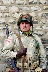 "Pickering 1940s war weekend. A reenactor portrays a member of a US Airborne unit complete with personal weapon and ""Pineapple"" fragmentation grenade, 2009 Image Copyright Paul David Drabble"