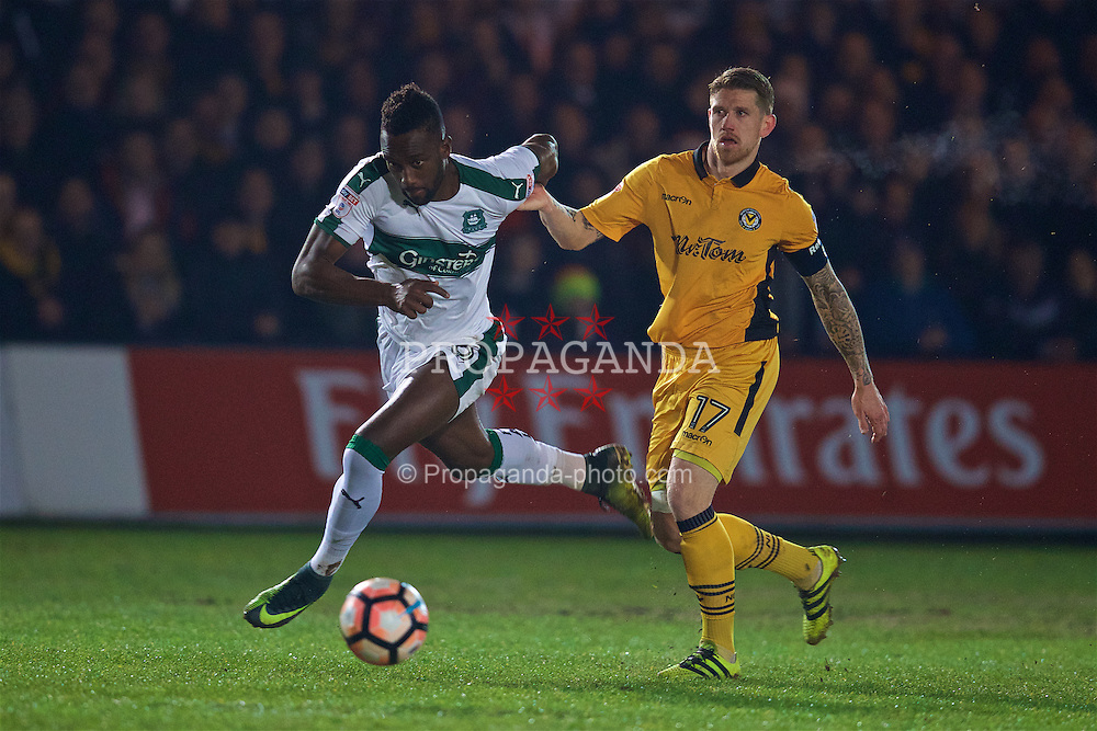 NEWPORT, WALES - Wednesday, December 21, 2016: Newport County's Scot Bennett in action against Plymouth Argyle's Jordan Slew during the FA Cup 2nd Round Replay match at Rodney Parade. (Pic by David Rawcliffe/Propaganda)