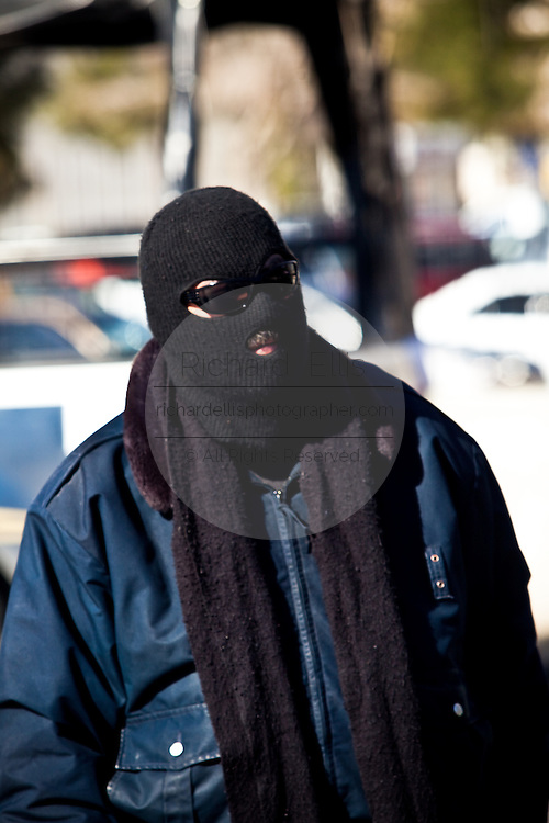 Masked Mexican Federal Police man a random check of vehicles in Juarez, Mexico January 15, 2009. An ongoing drug war has already claimed more than 40 people since the start of the year. More than 1600 people were killed in Juarez in 2008, making Juarez the most violent city in Mexico.    (Photo by Richard Ellis)