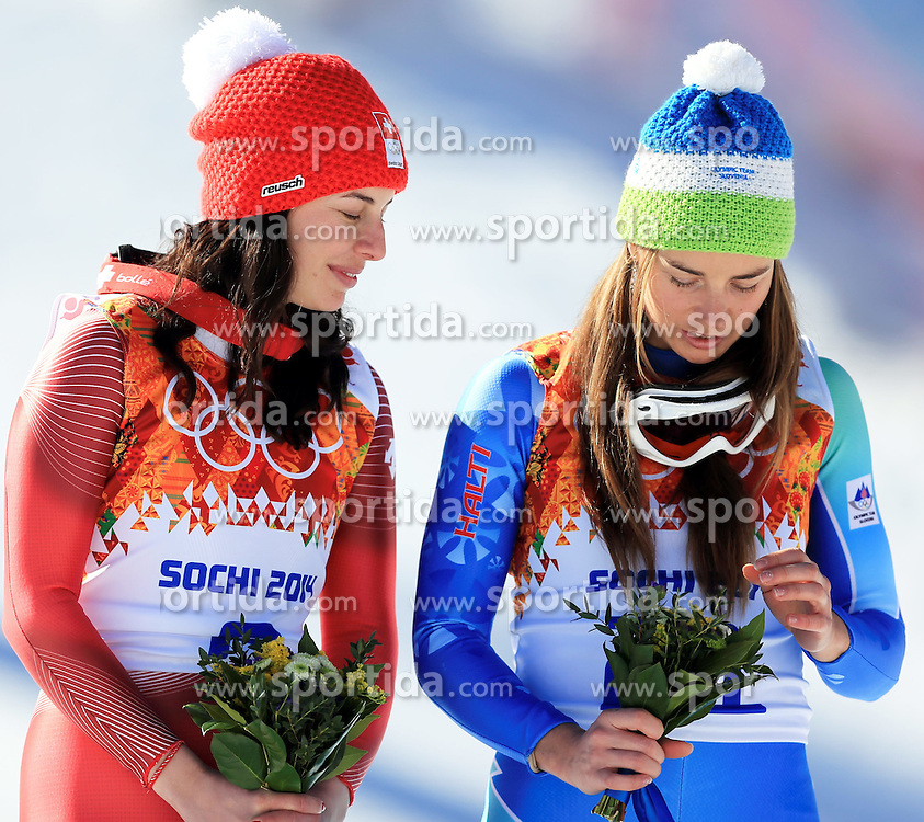 12.02.2014, Rosa Khutor Alpine Center, Krasnaya Polyana, RUS, Sochi, 2014, Abfahrt, Damen, Flower Ceremonie, im Bild die beiden Olympiasiegerinnen Tina Maze (r / SLO, Dominique Gisin (SUI) // The olympic Champions Tina Maze of Slovenia (right) and Dominique Gisin of Switzerland during the ladies downhill Flower Ceremony to the Olympic Winter Games 'Sochi 2014' at the Rosa Khutor Alpine Resort, Krasnaya Polyana, Russia on 2014/02/12. EXPA Pictures &copy; 2014, PhotoCredit: EXPA/ Stefan Matzke <br /> <br /> *****ATTENTION - OUT of GER*****