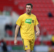 Kevin McDonald of Fulham wears a Kick It Out t-shirt whilst warming up prior the Sky Bet Championship match at the New York Stadium, Rotherham<br /> Picture by James Wilson/Focus Images Ltd 07709 548263<br /> 01/04/2017