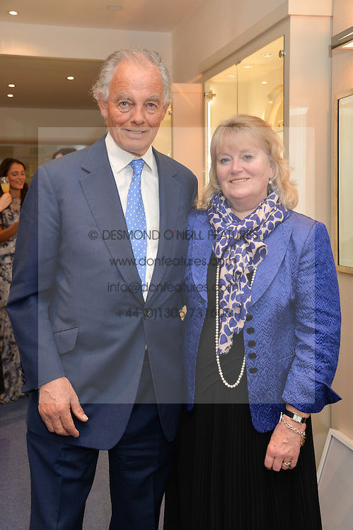 The 4th MARQUESS OF READING and MARCHIONESS OF READING at a preview of the latest collections by jewellery designer Kiki Mcdonough and fashion label Beulah held at Kiki McDonough Jewellery, 12 Symons Street, London on 5th March 2014.