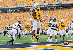 Sep 3, 2016; Morgantown, WV, USA; West Virginia Mountaineers running back Rushel Shell (7) scores a touchdown during the first quarter against the Missouri Tigers at Milan Puskar Stadium. Mandatory Credit: Ben Queen-USA TODAY Sports