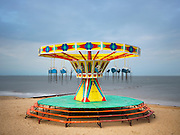 Carousel Sways Fornlornly on UK Coast