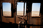 The bottom of The Aral Sea is seen from pilothouse of an abandoned ship. By 2007, The Aral Sea had declined to 10% of its original size, splitting into four lakes.