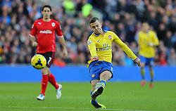 Arsenal's Jack Wilshere takes a shot - Photo mandatory by-line: Gary Day/JMP - Tel: Mobile: 07966 386802 30/11/2013 - SPORT - Football - Cardiff - Cardiff City Stadium - Cardiff City v Arsenal - Barclays Premier League